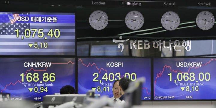 Asya para birimleri karışık seyretti, borsalar yükseldi