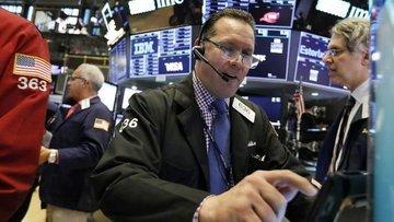 Küresel Piyasalar: Hisseler karışık seyretti, dolar geriledi