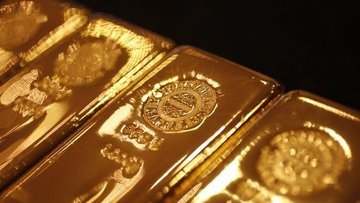 Altın dolardaki yükselişle 10 ayın zirvesinden düştü