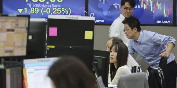 Asya hisse senetleri devam eden ticaret gerilimiyle karışık seyretti