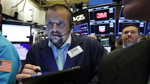 Küresel Piyasalar: Hisseler ticaret savaşı ile düşerken tahviller yükseldi