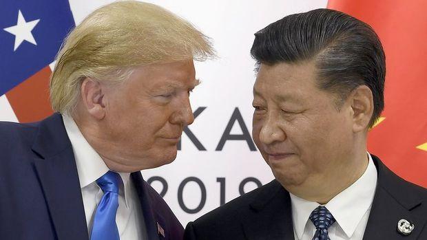 Trump Çin'e uygulanacak ek yüzde 5 gümrük tarifesini erteledi