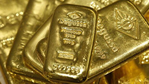 Altın zayıf ABD verisi sonrası kazancını korudu