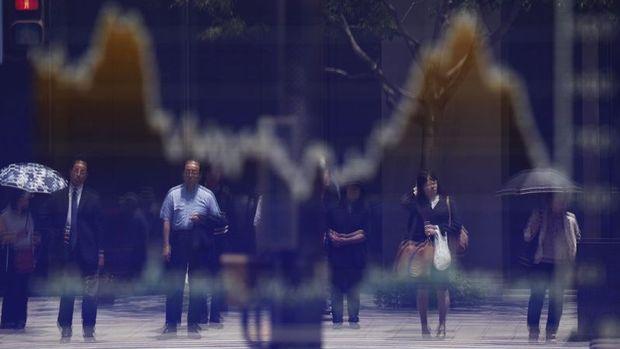 Asya borsaları haftanın son işlem gününde karışık seyretti