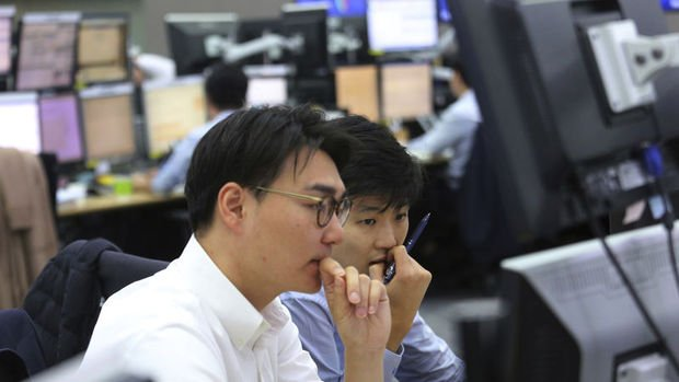Asya paraları yuan ve baht öncülüğünde düştü