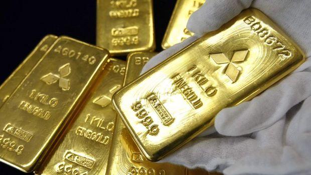 Altın yatırımcıların teşvik görünümünü değerlendirmesiyle kazancını korudu