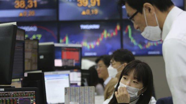 Asya borsaları teşvik iyimserliği ile hafif yükseldi