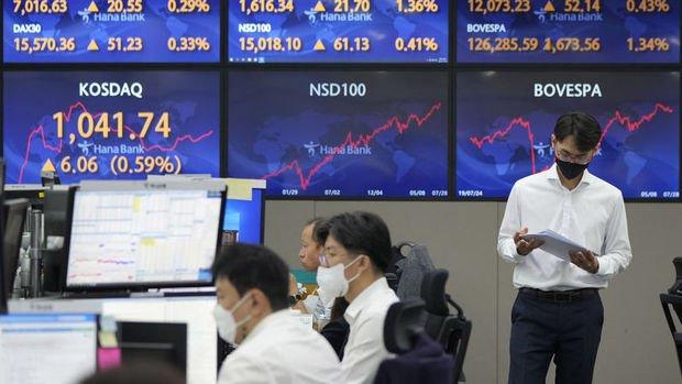 Asya borsaları yoğun veri akışı ile dalgalı seyretti