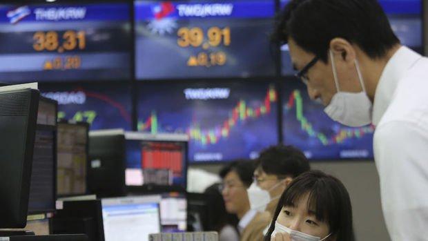 Asya borsaları Çin'in büyüme tahminlerinin düşürülmesiyle geriliyor